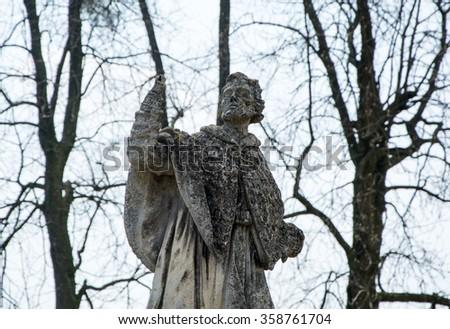 sculpture old man - stock photo