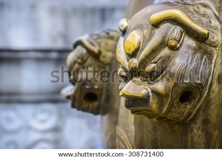 Sculpture on water vat, built in Qing Dynasty, Guangxu period. Located in Summer Palace, Beijing, China. - stock photo
