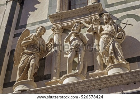 Sculptures of Baptism of Christ - on baptistery of St. John in Florence, Italy
