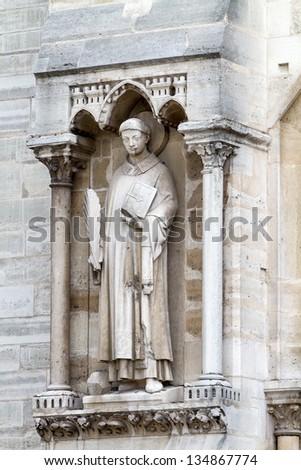 Sculptures of saints in the exterior of Notre Dame de Paris - stock photo