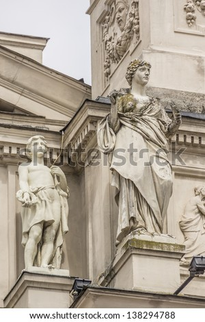 Sculptures on facade of Lviv State Academic Opera and Ballet Theatre. Theatre was built in classical tradition of Renaissance and Baroque architecture (Viennese neo-Renaissance style). Ukraine. - stock photo