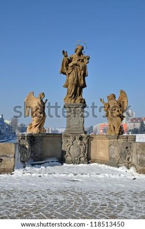 Sculptures on old bridge Pisek - stock photo