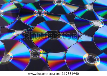 sd card with stack of dvd dish - stock photo
