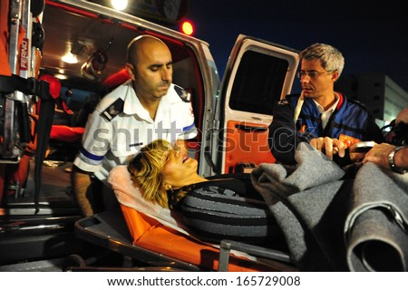 SDEROT, ISR - DEC 17:Injured woman evacuated by Magen David Adom on Dec 17 2008. In 2006, Magen David Adom has been officially recognized by the Red Cross (ICRC) as the national aid society of Israel. - stock photo