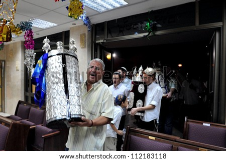 SDEROT, ISRAEL - OCTOBER 14:Orthodox Jewish men celebrate Simchat Torah in Sderot, Israel. Simchat Torah is a celebratory Jewish holiday marks the completion of the annual Torah reading cycle. - stock photo
