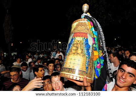 SDEROT, ISRAEL - OCTOBER 14 2006:Orthodox Jewish youth celebrate Simchat Torah in Sderot, Israel. Simchat Torah is a celebratory Jewish holiday marks the completion of the annual Torah reading cycle. - stock photo