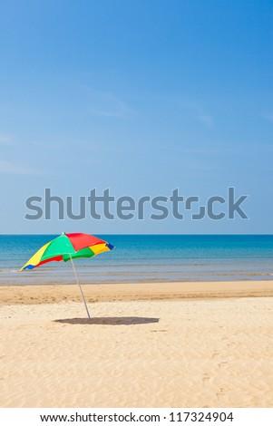 sea and beach umbrella - stock photo