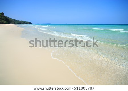 Sea and beautiful sandy beach in sunny sky.Tropical beach sand with calm sea.Ocean Beach in Thailand.selective focus.soft focus the field for background.