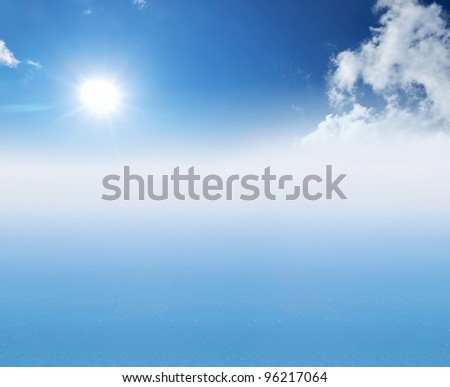 Sea and blue sky. Bright solar glow - stock photo