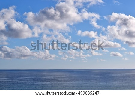 sea and blue sky with clouds in autumn