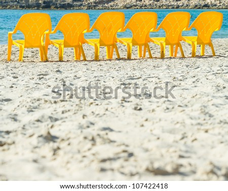 Sea and chairs on the beach - stock photo