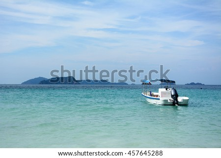 sea and cloudy sky background with one speed boat in the distance