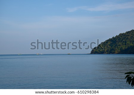 Sea and green hill with morning blue sky,  Ko Surin, Phangnga, Southern of Thailand, Andaman sea