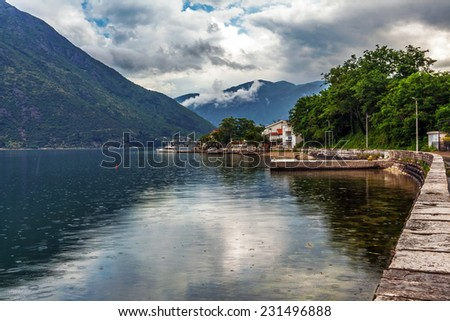 sea and mountains in bad rainy weather. Montenegro - stock photo