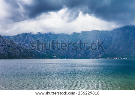 sea and mountains in gloomy weather. Montenegro - stock photo