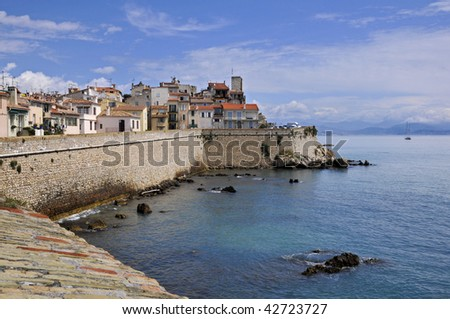 Sea and town of Antibes with its wall in southeastern France, mediterranean area