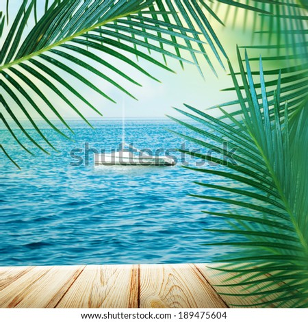 Sea background with palm leaves.