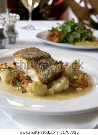 Sea Bass with Cauliflower - stock photo