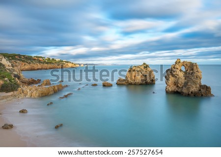 Sea bay with views of Albufeira. Blurred clouds at sunset. - stock photo