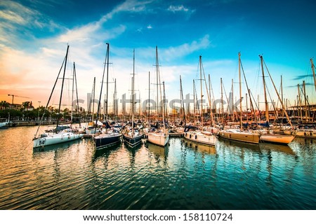 Sea bay with yachts at sunset - stock photo