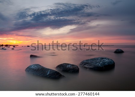 Sea beach and breakwater at sunset