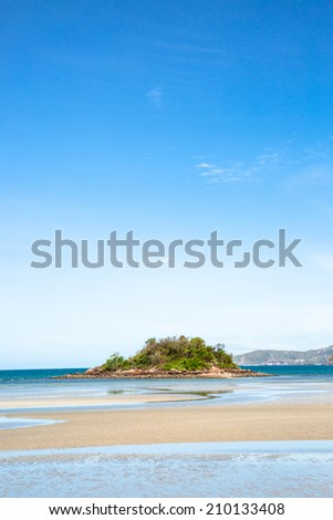 Sea beach and small island in ebb tide time in sunshine day  - stock photo