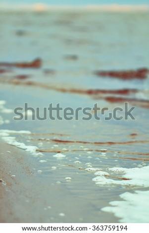 sea beach at sunset in summer, retro style photo - stock photo