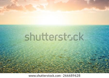 sea beach at the sunset - stock photo