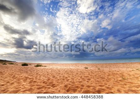 Sea beach in sun evening. Wide angle view. - stock photo