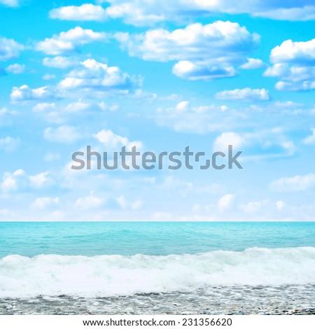 sea beach on background summer sky - stock photo