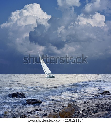 Sea before the storm and the boat - stock photo