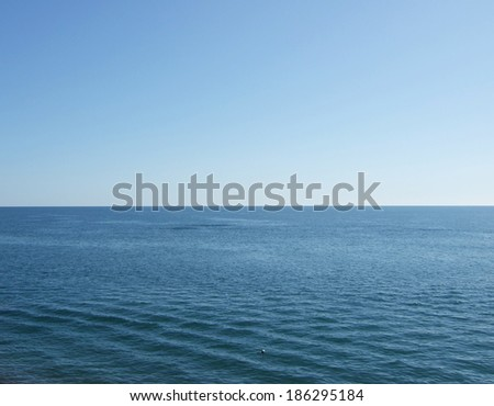 sea, blue sky and horizon - stock photo