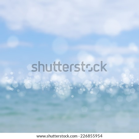 sea blurred background with glares and bokeh - stock photo