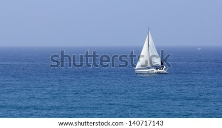 sea boat with white sails