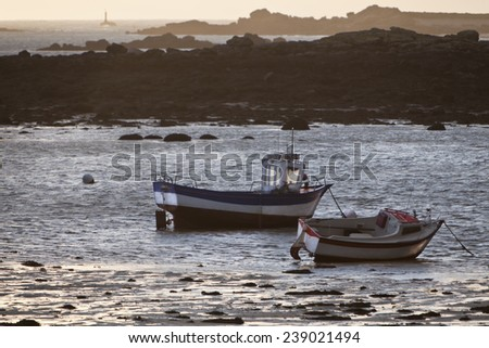 Sea boats in low tide in France
