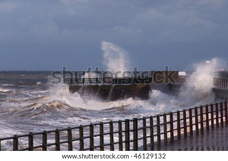 Sea breaking on sea front at Maryport - stock photo
