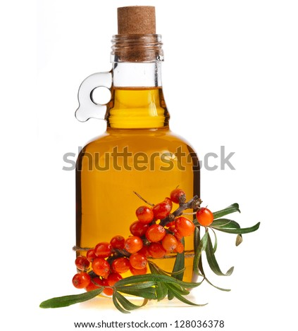 sea-buckthorn berries cluster and oil bottle jar isolated on a white background - stock photo