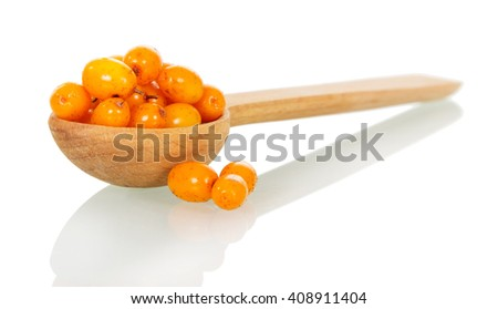 Sea-buckthorn berries in a wooden spoon isolated on white background. - stock photo