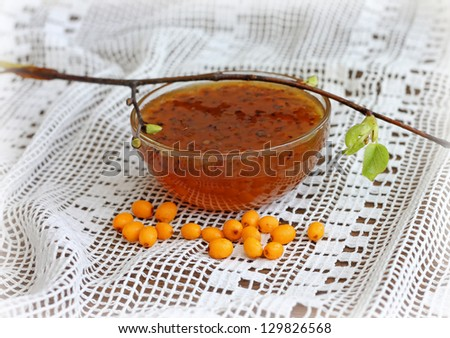Sea buckthorn jam with branch, close-up - stock photo