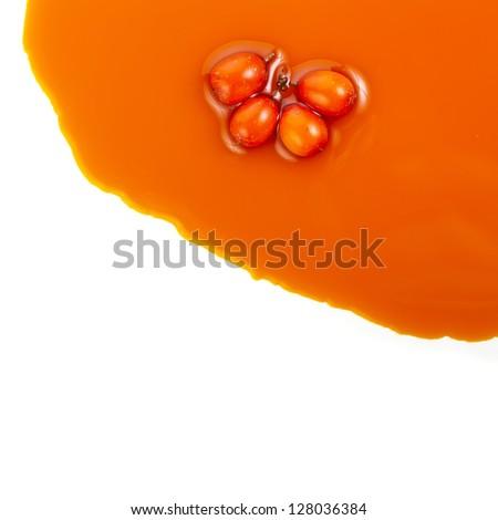 sea-buckthorn sallow thorn oil spread  texture isolated on white - stock photo