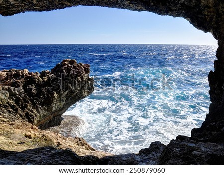 sea caves and cliffs of the island of Cyprus - stock photo