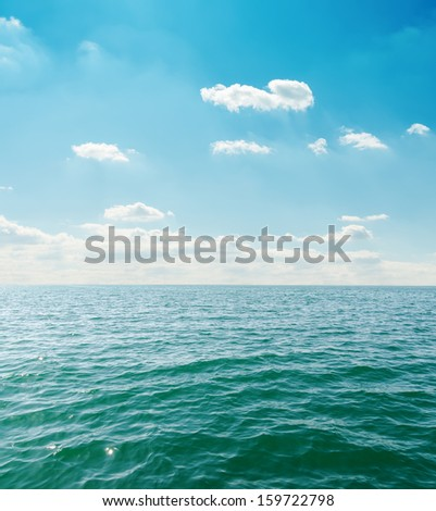 sea close up under clouds on sky