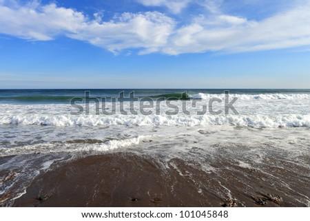 Sea, clouds, and sunshine - stock photo