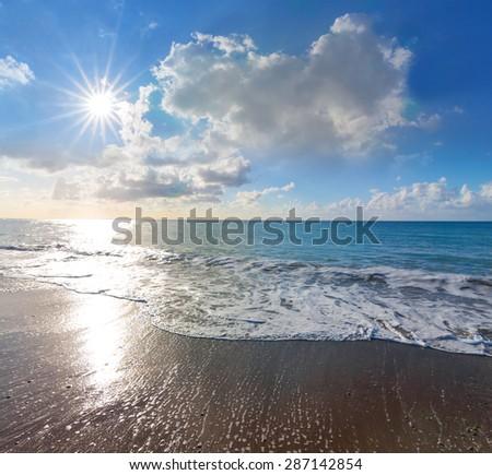 sea coast and sparkle sun - stock photo