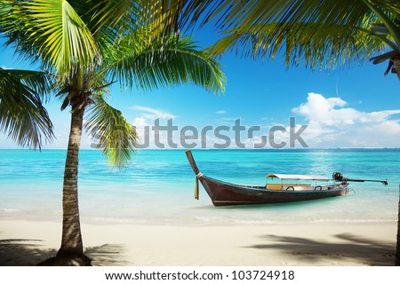 sea, coconut palms and boat - stock photo