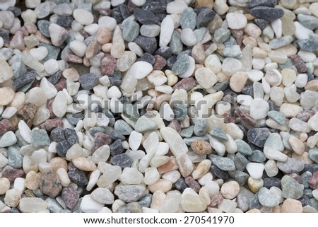sea colored pebbles scattered on the beach - stock photo