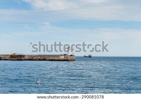 Sea embankment and lighthouse in Yalta. Yalta is a popular Crimean resort. Crimea. Ukraine. Russia - stock photo