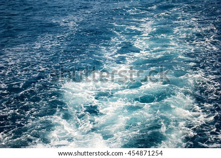 Sea foam of the waves which is made behind the boat