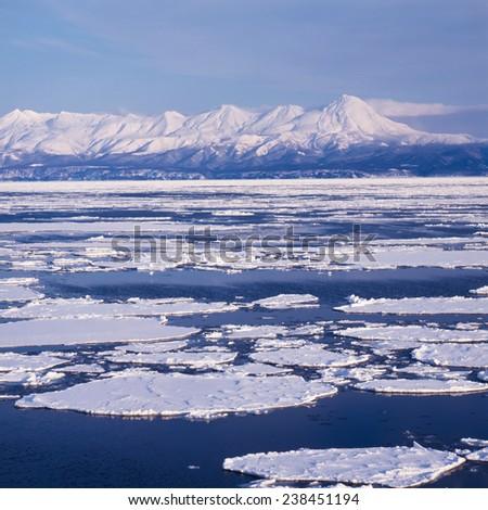 Sea ice and mountain - stock photo
