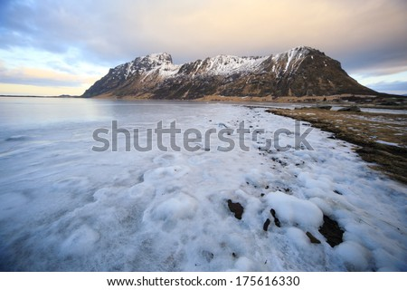 sea ??ice and snow-capped mountains islands logoten Arctic Circle Norway - stock photo